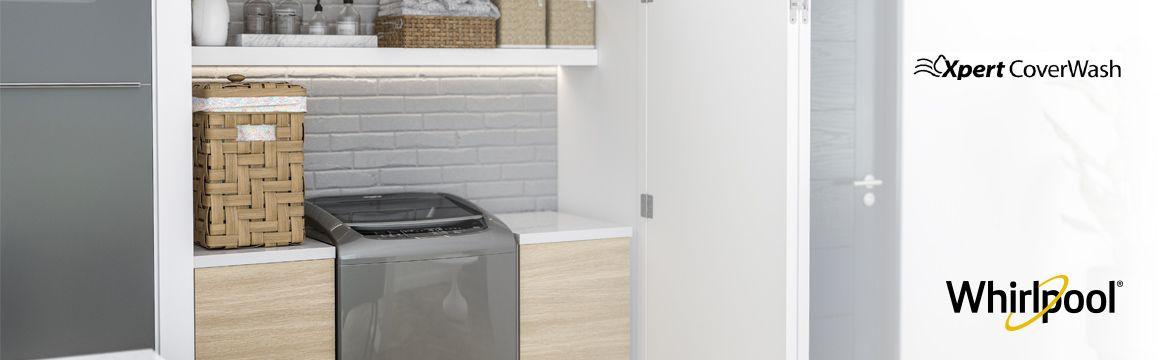 Lavadora Whirlpool de 16 Kg carga superior Gris, Ambientada en una casa frente al comedor en un espacio adecuado para cuarto de ropas. Se ve muy bien en espacios abiertos a zonas sociales del hogar. WWI16BSBLA - 881969082