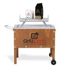 GRILLCORP - Caja China Mediana Jr + Parrilla de V Fija + Carbón + Pack Sal